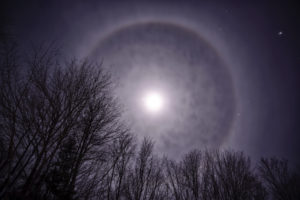 Photo of the night sky featuring a Moon Corona or Halo on a winter's night.